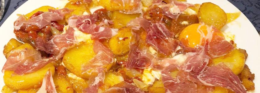Dónde comer huevos rotos con jamón en Bilbao